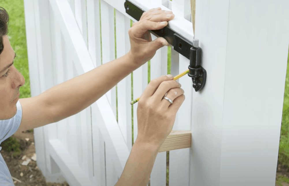 Install hinges and mount the gate to the fence